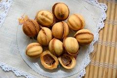 Nueces dulces con leche condensada Foto de archivo