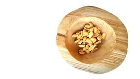 Nueces en cuenco de madera Fotografía de archivo libre de regalías