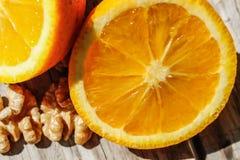 Nueces y naranja Fotografía de archivo