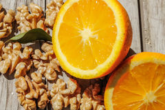 Nueces y naranja Fotos de archivo libres de regalías