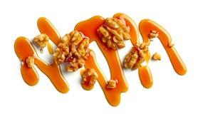 Nueces y salsa del caramelo foto de archivo libre de regalías