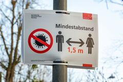 Free NUERNBERG, GERMANY - March 27, 2020: Sign In German About Keeping A Minimum Distance Due To The Corona Virus Stock Image - 177112131