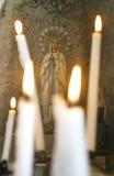 Nuestra señora de Lourdes con las velas foto de archivo libre de regalías