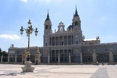 Nuestra Senora de La Almudena. The Nuestra Senora de La Almudena Cathedral facade in Madrid and a golden lamp of the Madrid Royal Palace Stock Photography