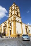 Nuestra Senora de la Soledad Church in Cuba. Camaguey / Cuba - March 11th, 2015: Nuestra Senora de la Soledad Church. People walk and cycle past this beautiful royalty free stock photography