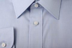Nueva camisa azul Foto de archivo libre de regalías