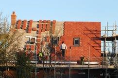 Nueva casa de la estructura, nueva azotea Foto de archivo libre de regalías
