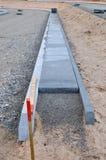 Nueva construcción y escombros de la acera vertidos Fotografía de archivo