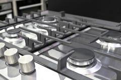 Nueva estufa de gas moderna con cuatro hornillas para la cocina, superficie de acero inoxidable fotografía de archivo