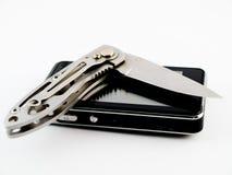 Nueva lámina del teléfono celular de la pantalla táctil y de cuchillo de caza imágenes de archivo libres de regalías