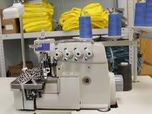 Nueva máquina de coser en la producción Imágenes de archivo libres de regalías