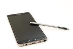 Nueva nota 5 de la galaxia de Smartphone Samsung con la pluma de S Imagenes de archivo