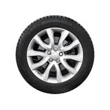 Nueva rueda automotriz brillante en el disco de la aleación ligera aislado imagen de archivo