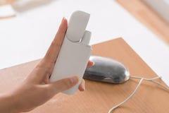 Nueva tecnología de cigarrillos electrónicos, sistema de calefacción de a fotografía de archivo libre de regalías