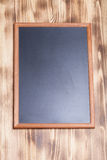 Nueva textura quemada de madera ligera con el tablero de tiza para el fondo Fotografía de archivo libre de regalías