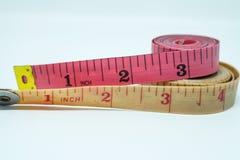 Nueva y vieja cinta métrica Imagen de archivo libre de regalías