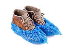 Nuevas cubiertas del zapato en el zapato imágenes de archivo libres de regalías