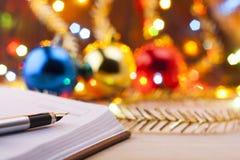Nuevas entradas Lista de lío al Año Nuevo Lista de compras antes del Año Nuevo Imagen de archivo