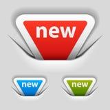 Nuevas escrituras de la etiqueta sujetadas del triángulo Imagenes de archivo