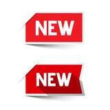 Nuevas etiquetas rojas del papel del vector Imagen de archivo