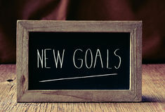 Nuevas metas del texto en una pizarra Fotos de archivo libres de regalías