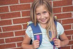 Nueve años de la estudiante en la escuela Foto de archivo