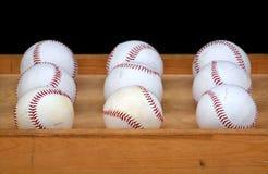 Nueve béisboles Fotos de archivo libres de regalías