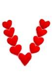 Nueve corazones arreglaron en la dimensión de una variable de un V Imagenes de archivo