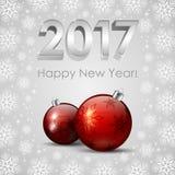 Nuevo 2017 años, chucherías rojas y copos de nieve Imagen de archivo libre de regalías