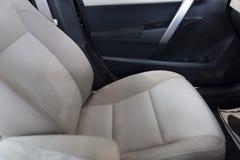 nuevo asiento de pasajero de la tela en coche fotografía de archivo