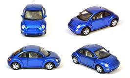 Nuevo coche azul del escarabajo de VW aislado Imagen de archivo libre de regalías