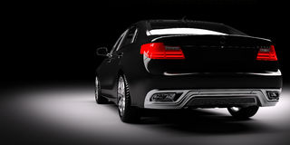 Nuevo coche metálico negro del sedán en proyector El desing moderno, brandless imagen de archivo libre de regalías