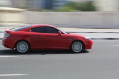 Nuevo coche rojo Imágenes de archivo libres de regalías