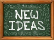 Nuevo concepto de las ideas Iconos del garabato en la pizarra Fotos de archivo