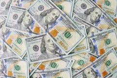 Nuevo fondo de 100 billetes de dólar Imágenes de archivo libres de regalías