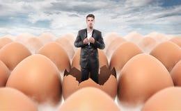 Nuevo hombre llevado de una cáscara de huevo imagen de archivo libre de regalías