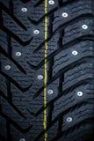 Nuevo neumático tachonado Fotografía de archivo libre de regalías