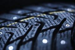 Nuevo neumático tachonado Imagen de archivo libre de regalías