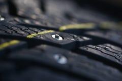 Nuevo neumático tachonado Foto de archivo
