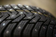 Nuevo neumático tachonado Foto de archivo libre de regalías