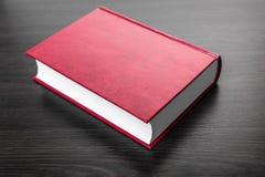 Nuevo primer del libro cerrado foto de archivo