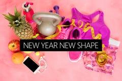 Nuevo texto de la forma del Año Nuevo en fondo temático de la aptitud imagen de archivo