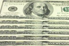 Nuevos billetes de banco de cientos dólares de fondo Fotos de archivo libres de regalías