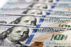 Nuevos cientos billetes de dólar Imagen de archivo libre de regalías