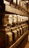 Nuevos contadores de potencia en vieja vertical de la configuración Foto de archivo libre de regalías