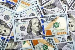 Nuevos dólares americanos, un fondo Fotos de archivo libres de regalías