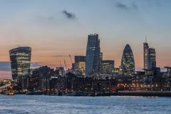 Nuevos rascacielos de la ciudad de Londres en la puesta del sol 2014 Foto de archivo libre de regalías
