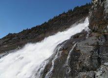 Nugget Falls at Juneau Alaska. Nugget Falls rushes with seasonal Spring snow melt near Mendenhall Glacier at Juneau Alaska stock images