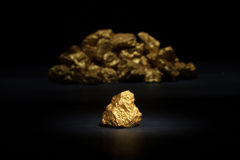Nugget gold. Closeup of big gold nugget Stock Images