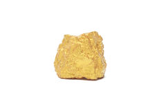 Nugget gold. Closeup of big gold nugget isolated on white background Royalty Free Stock Photography